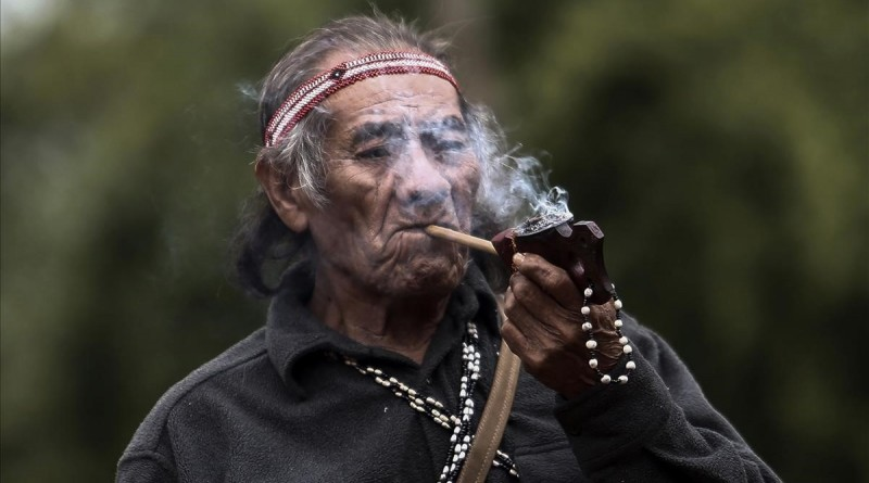 An indigenous man from a Guarani tribe smokes his pipe in the Pico de Jaragua national reserve  in Sao Paulo  Brazil  on August 31  2017   A group of natives and activists Thursdaay protested in Sao Paulo demanding the reversal of a judicial sentence revoking the demarcation of a reserve of 532 hectares in the state of Sao Paulo    AFP PHOTO   Miguel SCHINCARIOL