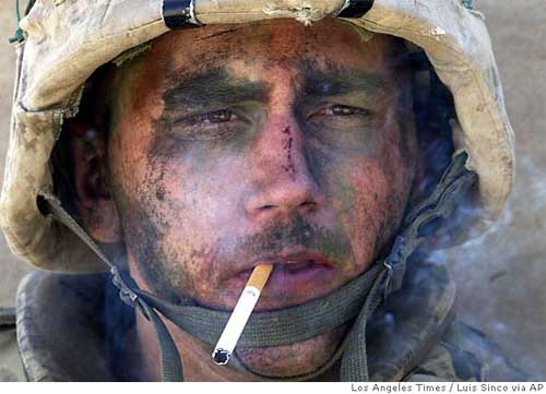 A member of Charlie Company of the U.S. Marines First Division, Eighth regiment, smokes a cigarette in Fallujah, Iraq, Tuesday, Nov. 9, 2004. U.S. forces punched into the center of the insurgent stronghold, overwhelming bands of guerrillas in the street with heavy barrages of fire and searching house to house in a powerful advance on the second day of a major offensive. (AP Photo/Los Angeles Times, Luis Sinco)  ** MANDATORY CREDIT,  NO SALES, NO FOREIGN, NO MAGS, LOS ANGELES DAILY NEWS OUT, OC REGISTEROUT, VENTURA COUNTY STAR OUT, INLAND VALLEY DAILY BULLETIN OUT, SAN BERNARDINO SUN OUT **  Ran on: 11-18-2004 Marine Lance Cpl. James Blake Miller has become an unwitting poster boy for the war in Iraq.  MANDATORY CREDIT: LUIS SINCO/LOS ANGELES TIMES,  NO SALES, NO FOREIGN, NO MAGS, LOS ANGELES DAILY NEWS OUT, OC REGISTER OUT, VENTURA COUNTY STAR OUT, INLAND VALLEY DAILY BULLETIN OUT, SAN BERNARDINO SUN OUT  Ran on: 11-20-2004 Heroic?: Photo of Marine sends wrong message, many readers say.  Ran on: 01-07-2005 Face that launched a billion butts: Life photographer Leonard McCombe shot this image of Texas rancher C.H. Long in 1949. The image inspired Chicago adman Leo Burnett in the makeover of Marlboro as a more manly cigarette.  Ran on: 01-29-2006 Blake Miller sits with his wife, Jessica, and Candi at the home where she grew up in Virgie, Ky. The couch is theirs, the flag blanket from his grandmother Mildred.