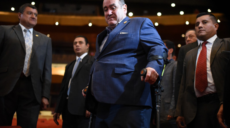 Guatemalan President-elect Alejandro Giammattei (C) arrives at the National Theater for a rehearsal of his swearing-in ceremony, in Guatemala City, on January 13, 2020. - Giammattei will take over on Tuesday as president of Guatemala until 2024 with the challenge of resuming governance to face poverty and corruption, as well as deciding whether to accept Mexicans who are asking for asylum in the United States. (Photo by Orlando  ESTRADA / AFP)