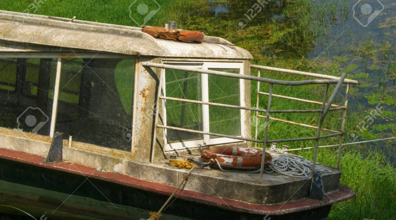 Old broken abandoned ferry for passengers on the rivershore