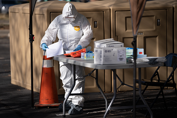 Tri-County Health official prepares her supplies before interacting with those in line to get tested for COVID-19, March 11, 2020 at the CDPHE Laboratory Services Division.  Photo by Philip B. Poston/Sentinel Colorado